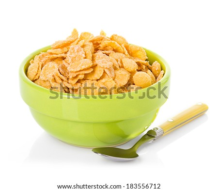 Bowl with corn flakes on the white background - stock photo