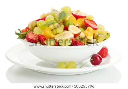 bowl with fresh fruits salad and berries isolated on white - stock photo