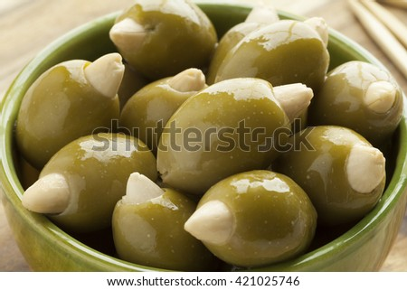 Bowl with green olives stuffed with an almond