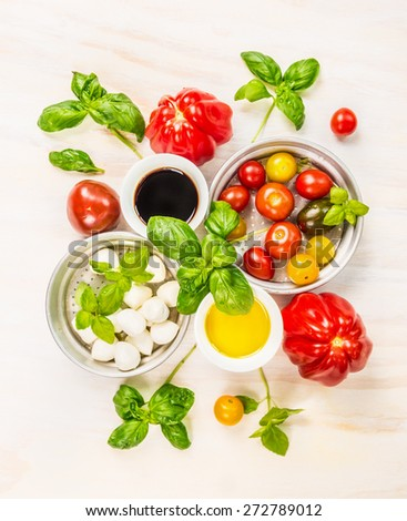 Bowl with mozzarella, tomatoes, basil, oil and vinegar , ingredients for salad making, top view - stock photo