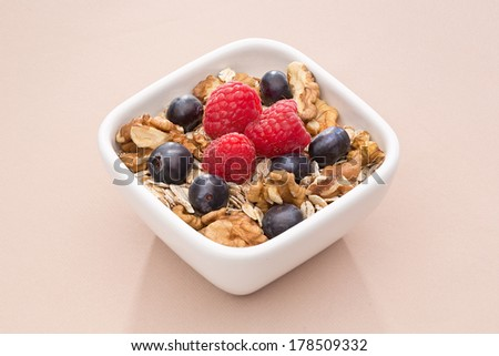 Bowl with muesli, nuts and berries - stock photo