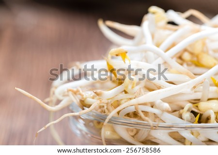 Bowl with Mungbean Sprouts on wooden background - stock photo