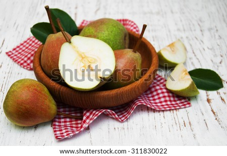 Bowl with pears on a old wooden background