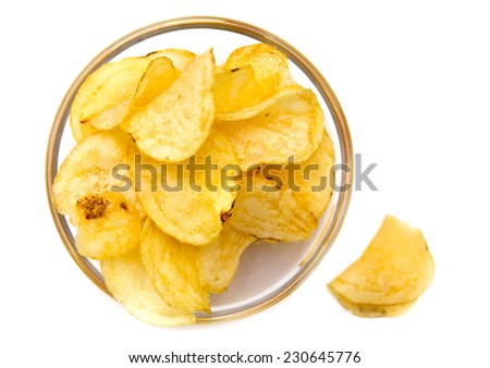 Bowl with potato chips on white background top view - stock photo