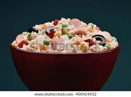 Bowl with rice salad spelled and barley sausage portion