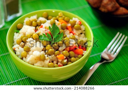 Bowl with risotto and vegetable - stock photo