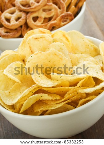 Bowl with salted potato chips. Shallow dof. - stock photo