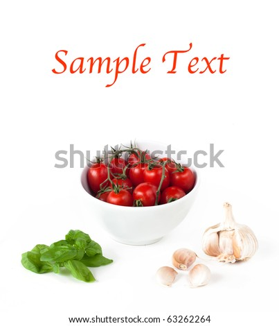 bowl with tomatoes, garlic and basil on white with example text - stock photo