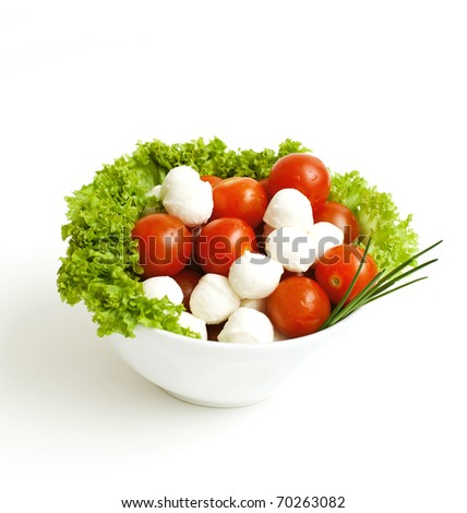 bowl with tomatoes, mozzarella and lettuce salad