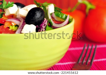 Bowl with vegetable salad on table - stock photo