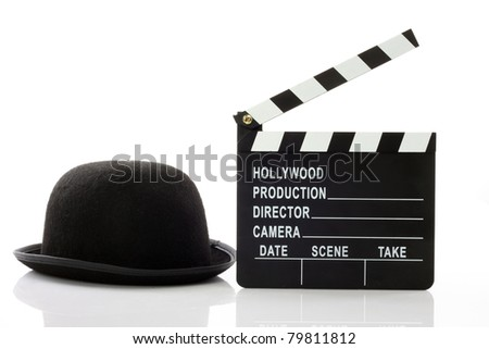 Bowler hat and movie clapper over white - stock photo
