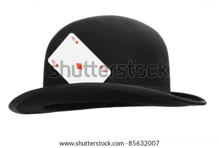 Bowler hat with hide ace. Hazard metaphor. - stock photo