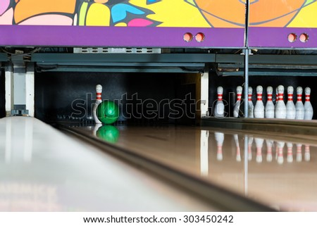 Bowling ball encounters the pin - stock photo