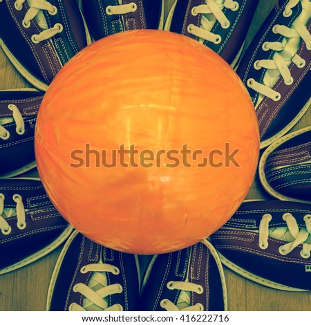 Bowling balls lined bowling shoes to celebrate victory - stock photo
