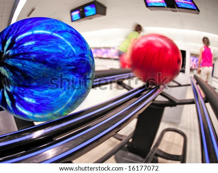 Bowling balls on return at alley - stock photo