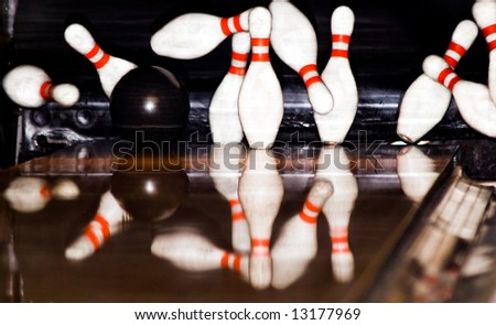 Bowling Game. A ball hitting the pins. - stock photo