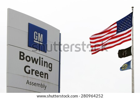 BOWLING GREEN, KY-MAY, 2015:  Sign for the Chevrolet Corvette assembly plant in Bowling Green, KY with an adjacent American flag.  This is the only Corvette plant in the world.  - stock photo