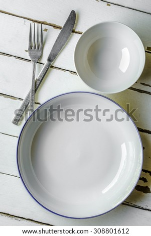 Bowls and knife on wood board, Utensils on wood board - stock photo