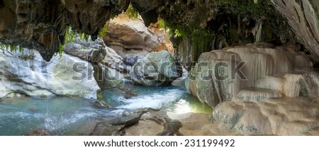 bowls of a mineral source in a grotto at the bottom of the Vorotansky gorge - stock photo