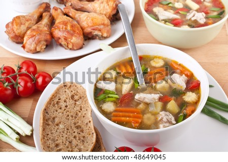 bowls of chicken and vegetable soup - stock photo