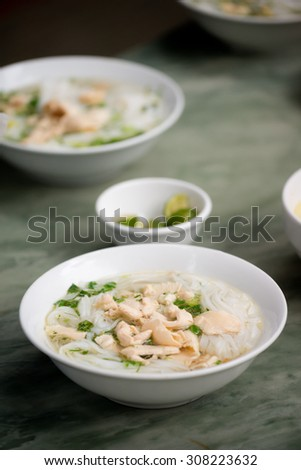 Bowls of Chicken Pho, in Vietnam - stock photo