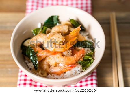 Bowls of delicious asian fried shrimp and rice - stock photo