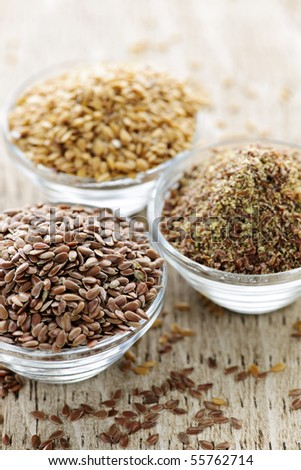 Bowls of whole and ground flax seed or linseed - stock photo