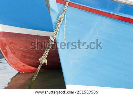 Bows of fishing boats in the harbor of Mevagissey, Cornwall, Great Britain - stock photo