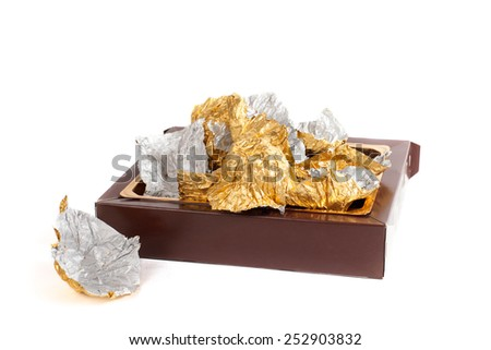 box and wrappers from chocolates - stock photo