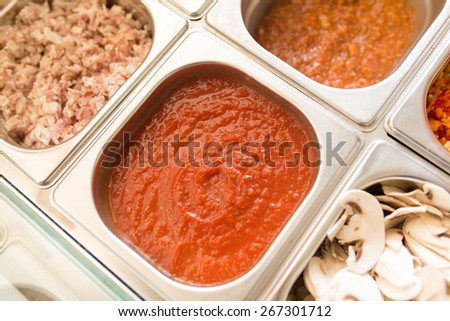 Box containers with tomato sauce, bolognese sauce, bacon and fresh mushrooms - stock photo