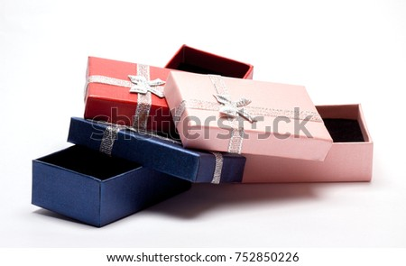 box for gift packaging with bow on white background