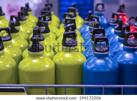 Box full of aluminum metallic water bottles in the market ready to sell - stock photo