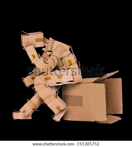 Box man deep thinking and sat on a box on a black background - stock photo