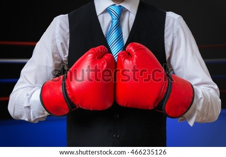 Box manager is fighting and boxing in ring.