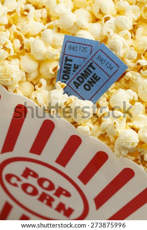 Box of Butter Popcorn with Two Blue Movie Tickets. - stock photo