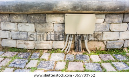 Box of electrical controls in the park - stock photo
