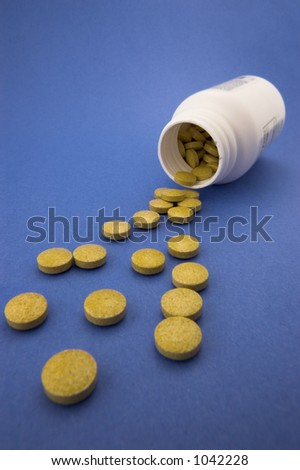 Box of pills on blue
