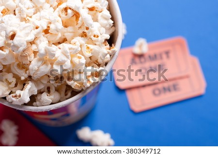 box of popcorn, tickets - stock photo