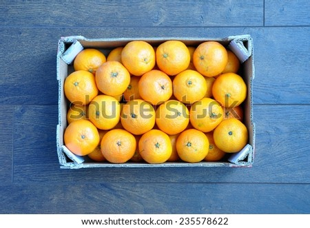 Box of sweet clementines - stock photo