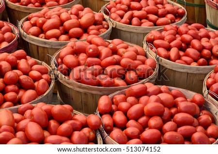 Box of tomatoes on a market stall