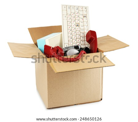 Box of unwanted stuff isolated on white - stock photo