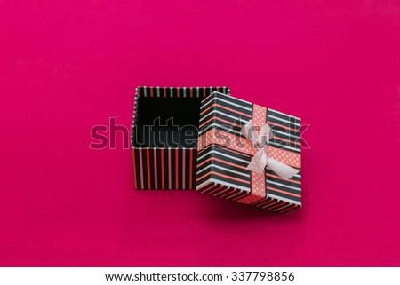box on pink fabric - stock photo