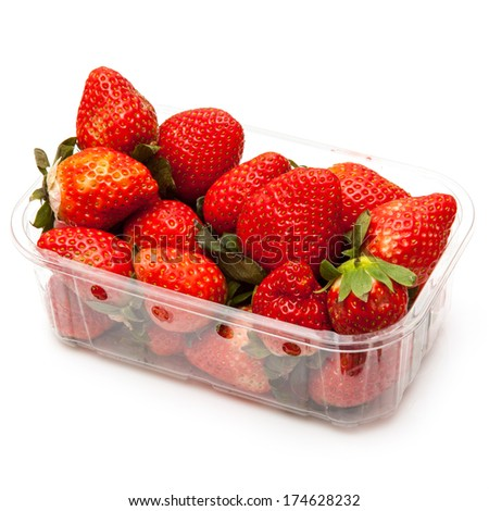 Box or punnet of strawberries isolated on a white studio background. - stock photo