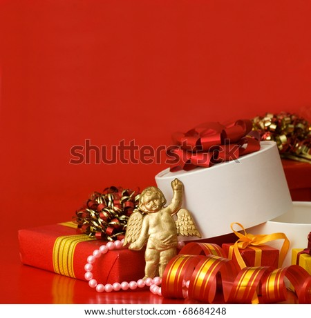 Box with a gift on a red background