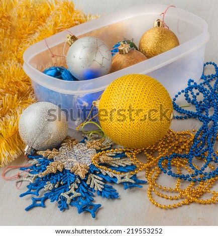 Box with Christmas decorations before starting holidays - stock photo