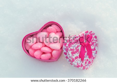 Box with hearts in the snow