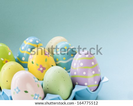 Box with painted easter eggs. - stock photo
