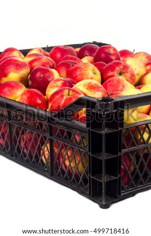box with red apples on a white background