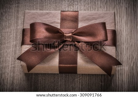 Boxed vintage gift container with brown ribbon celebration concept.