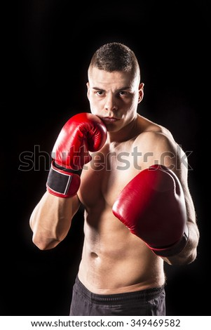 boxer man with boxing gloves isolated on black background - stock photo